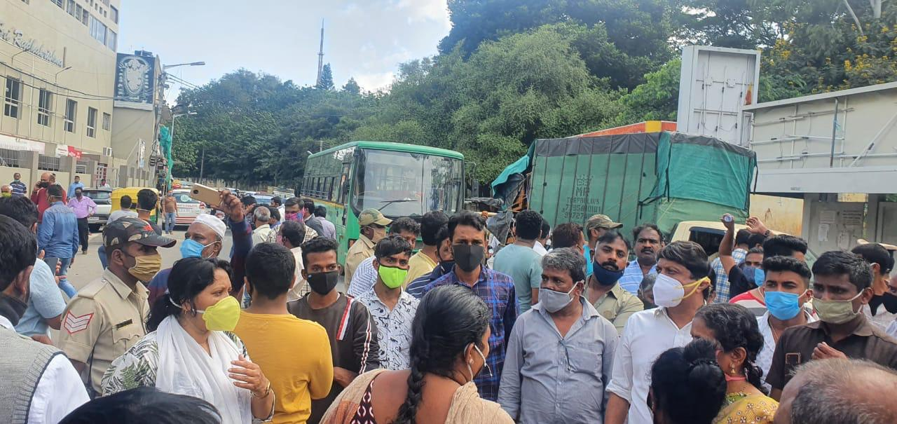 Protests over nodal officer's eviction drive JC Nagar locals block road, MLA wants officer replaced