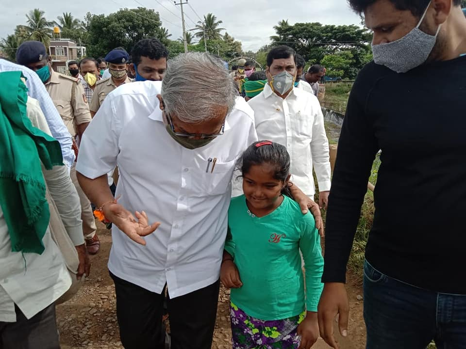 Education Minister Suresh Kumar interacting with one of the child.
