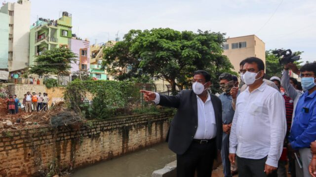 DCM orders razing of structures atop storm water drains Narayan feels drilling holes inside drains will make rain water recede!